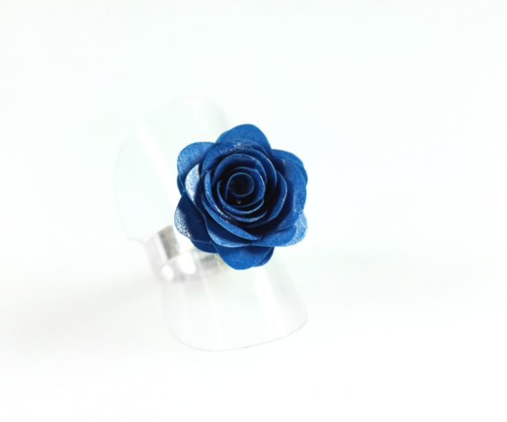 Silver ring with paper rose, front view