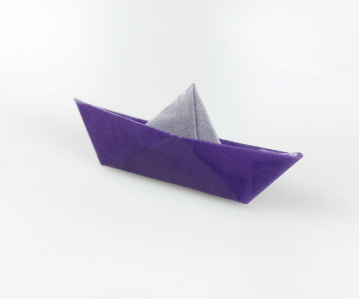 Paper boat in brooch for girl