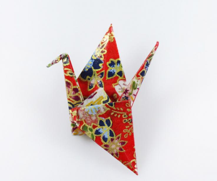 Original and creative costume jewellery used with paper crane brooch, front view