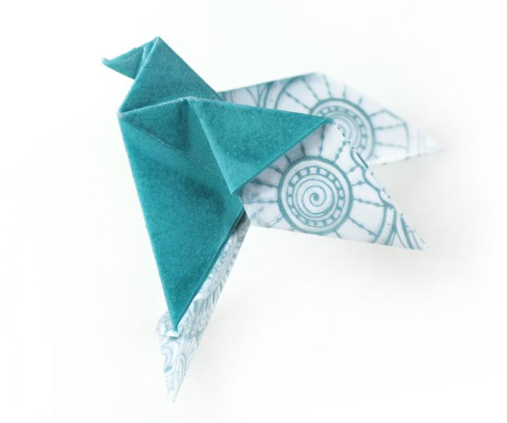Fashion accessory for woman, origami bird brooch, front view
