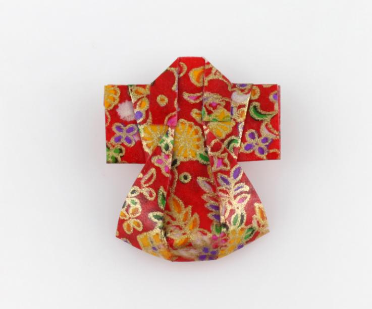 Red kimono costume jewelry, front view