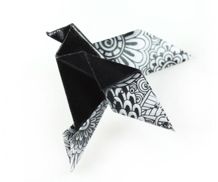 Origami bird with safety pin, front view