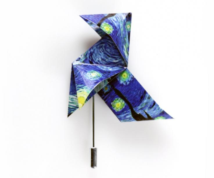 Origami bird shaped needle brooch with the image of Van Gogh's Starry Night. Fashion jewellery of low cost design