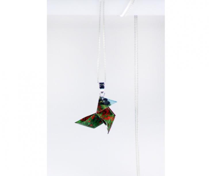 Joyas de Papel worships Van Gogh by folding his work Poppy Fields to transform it into the conventional origami bird and make it pendant