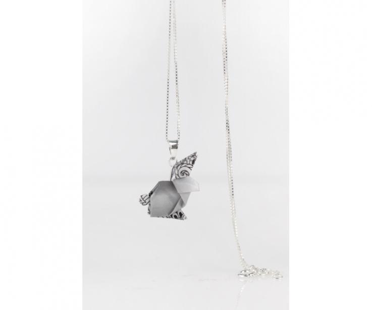 Silver pendant and black origami rabbit