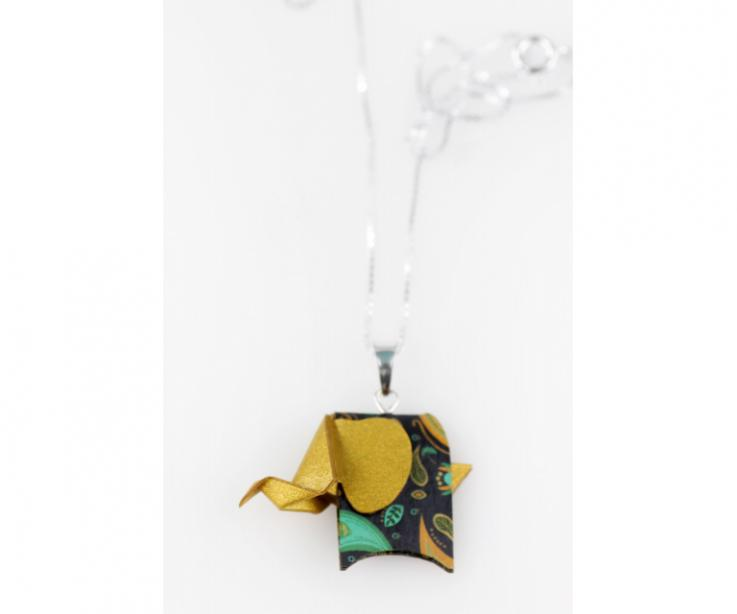 Silver pendant with a golden origami pachyderm