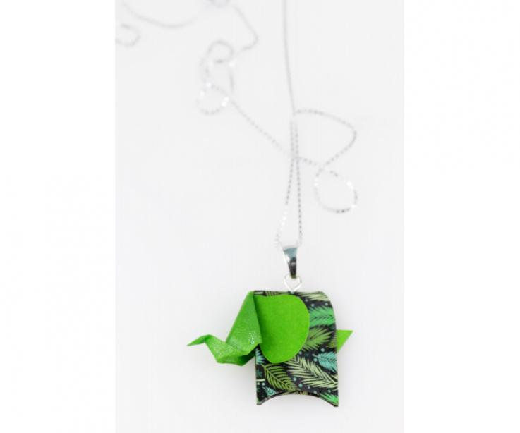 Silver pendant with a green origami pachyderm