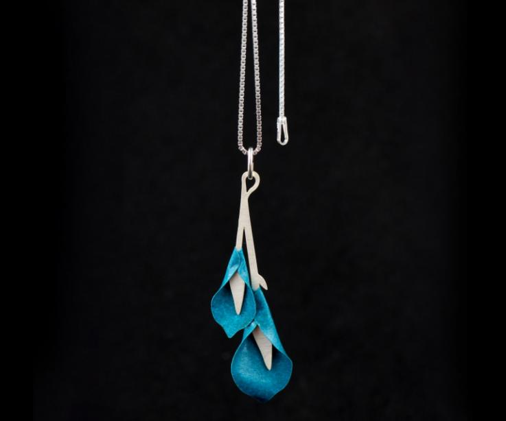 Pendant with two aquamarine paper lily flowers on a carved branch-shaped base and sterling silver Venetian chain.