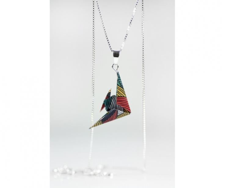 Fish hanging from sterling silver chain, women's accessory, front view
