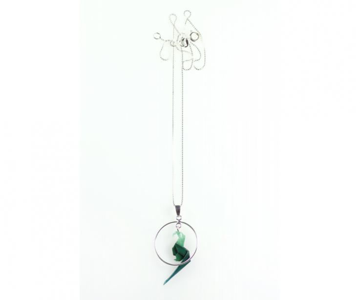 Origami parrot and silver pendant, front view