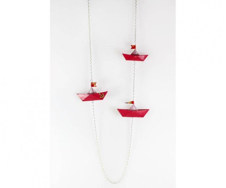 Creative necklace with paper boats and silver chain, front view