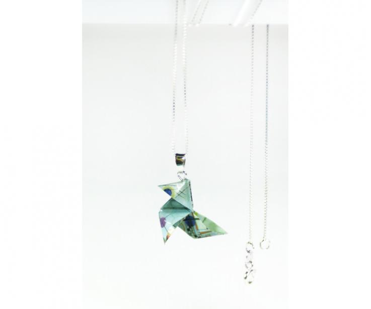 Small paper origami bird set as a pendant in sterling silver