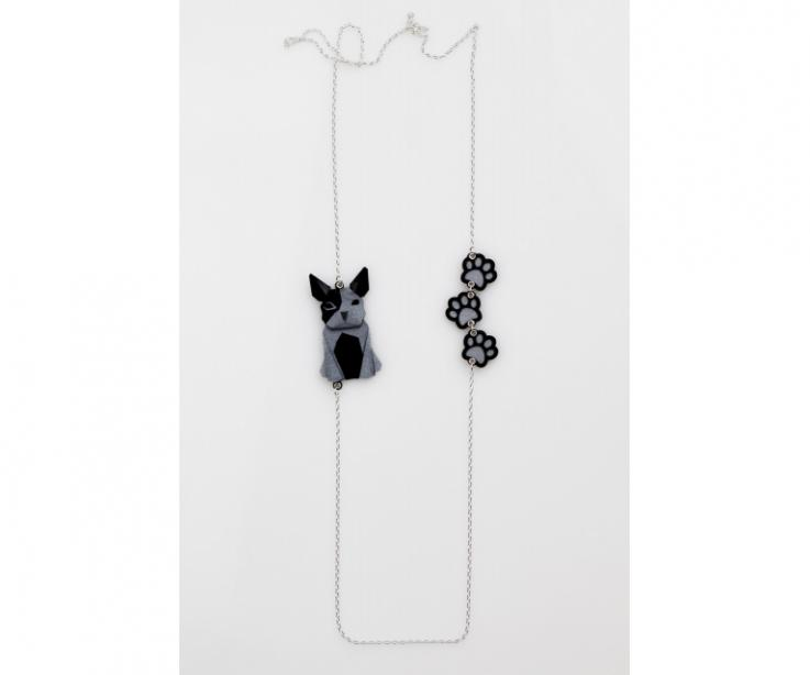 Silver necklace with a silver origami dog and footprints