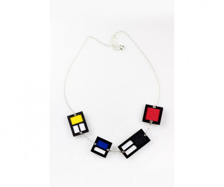 Necklace of paper and sterling silver inspired by the work of Mondrian with yellow, blue and red