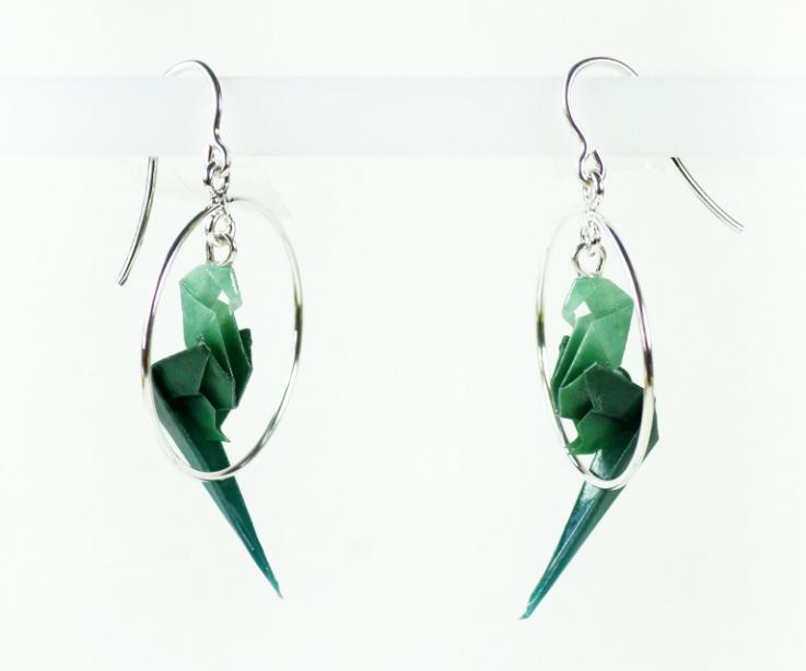 Fashion jewellery by the brand Joyas de Papel, parrot in silver hoop earrings