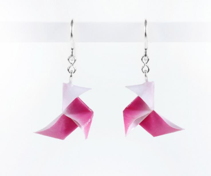 Economic earrings origami bird on paper