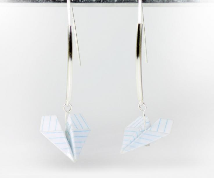 Earrings for women in the shape of a paper airplane, front view