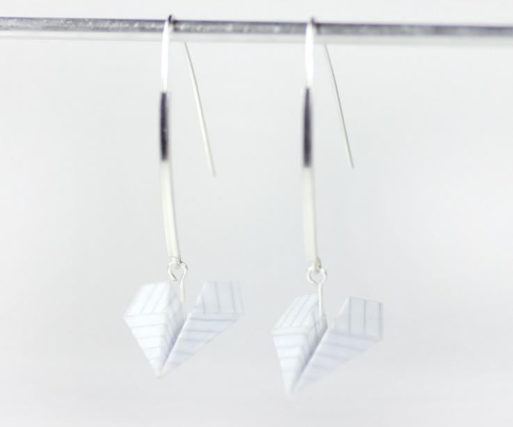 Handmade earrings in Spain with paper airplane and silver, front view