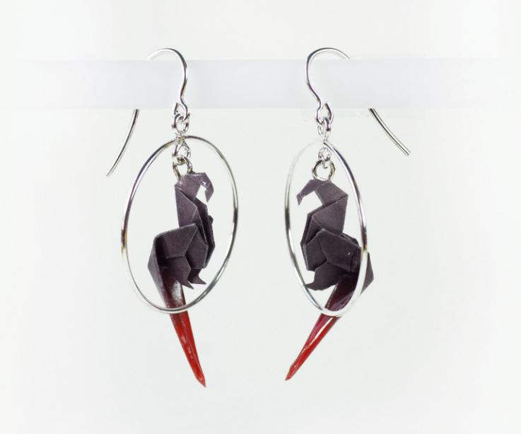 Modern parrot in hoop earrings on origami paper with sterling silver