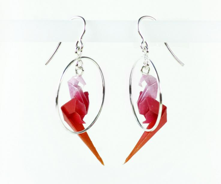 Modern and fashion earrings with parrot in hoop on paper and silver