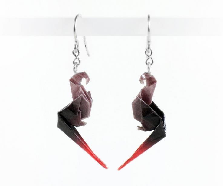 Handmade earrings with origami parrot