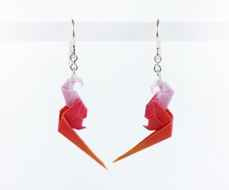 Fashionable earrings with origami parrots on paper and silver 925