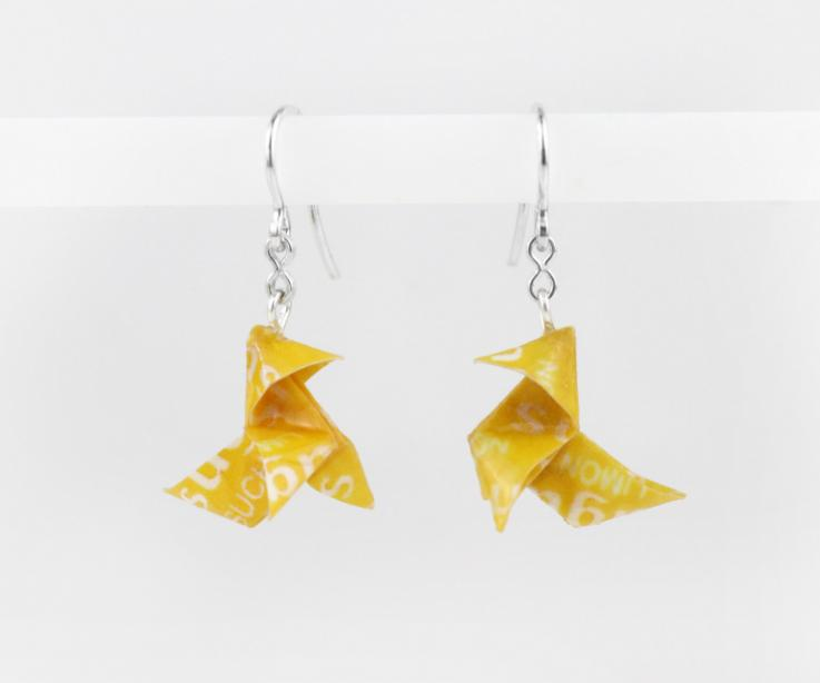 Origami bird earrings on paper and silver link, front view