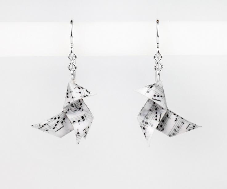Front view of a pair of elegant earrings with origami bird settings made with folded paper scores and silver hook clasps.