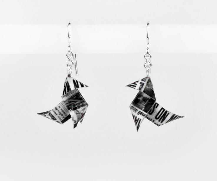 Front view of earrings with old newspaper origami bird, with semi gloss finish and set to silver hook type fasteners.