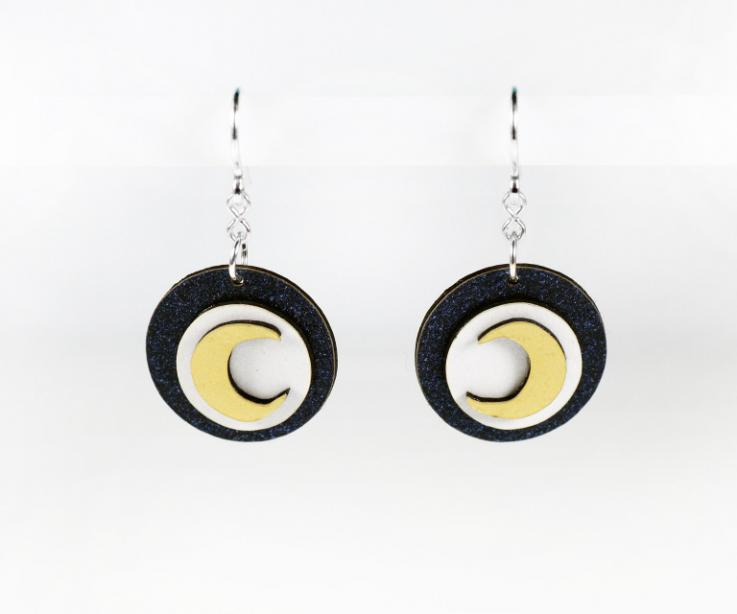 Earrings of paper and sterling silver with circular shape crowned by a golden moon.