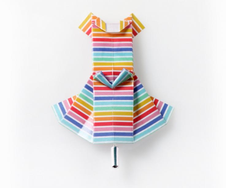 Brooch in the shape of an origami dress with colored stripes
