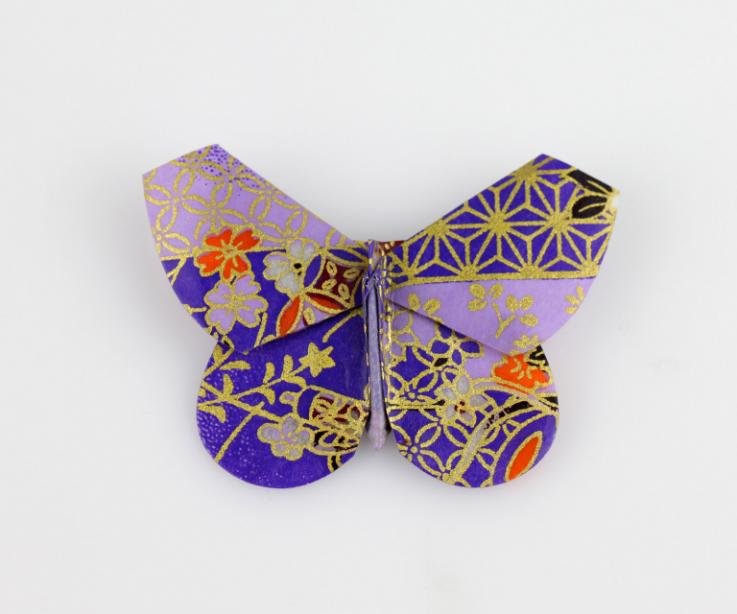Butterfly brooch with purple Japanese printed paper, front view