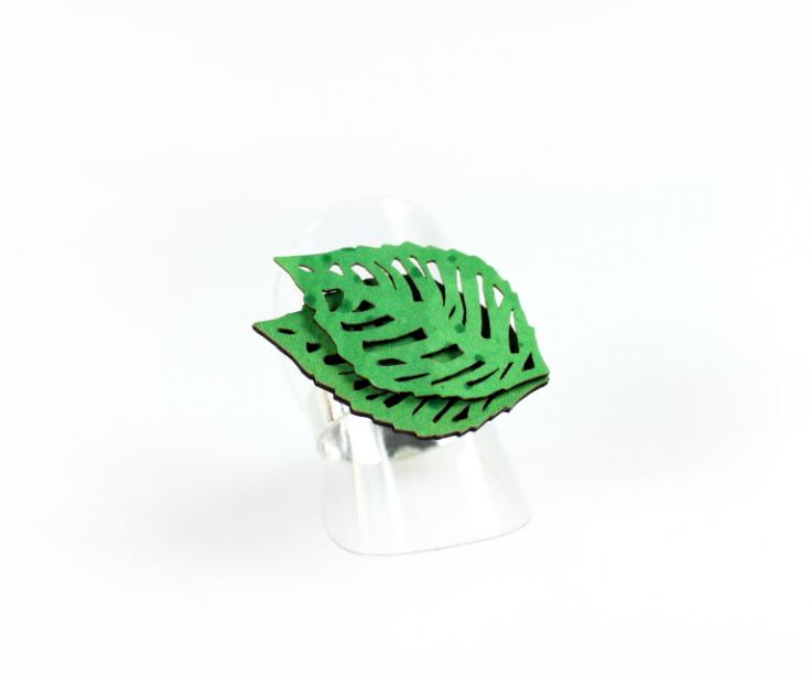 Stylish ring formed by silver base and leaf shape, front view