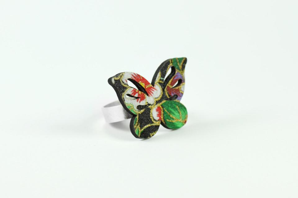 Paper and silver butterfly design ring, perspective view