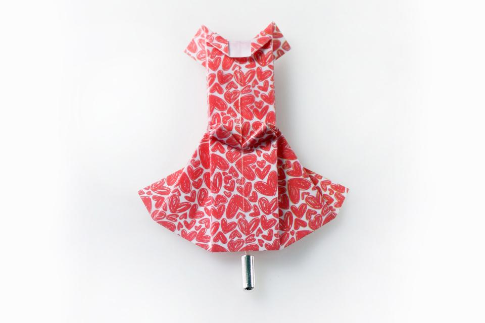 Jewelery brooch in the shape of a dress made of paper in red with hearts