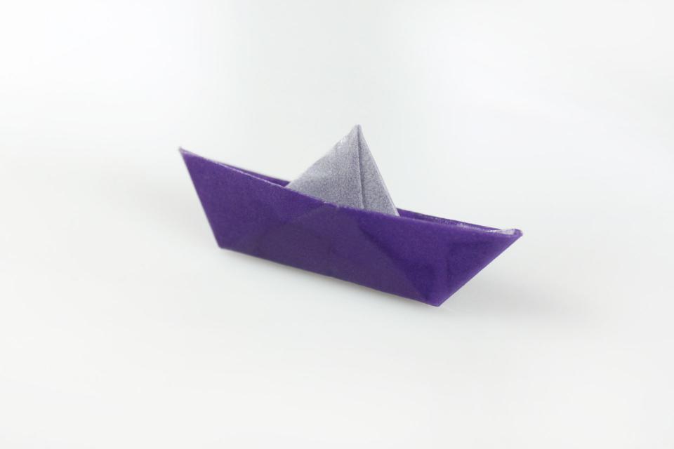 Paper boat in brooch for girl