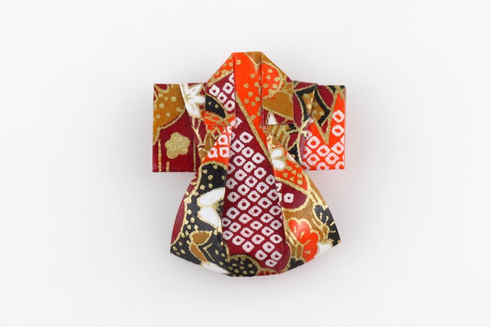 Paper origami kimono pin, front view