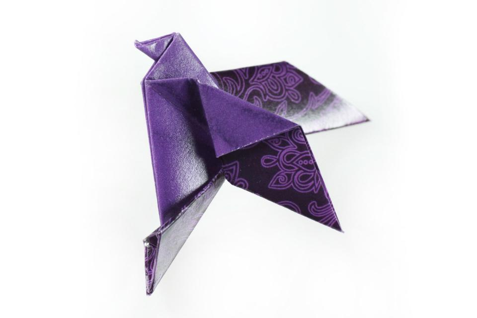 Origami paper fashion bird brooch with safety pin, front view