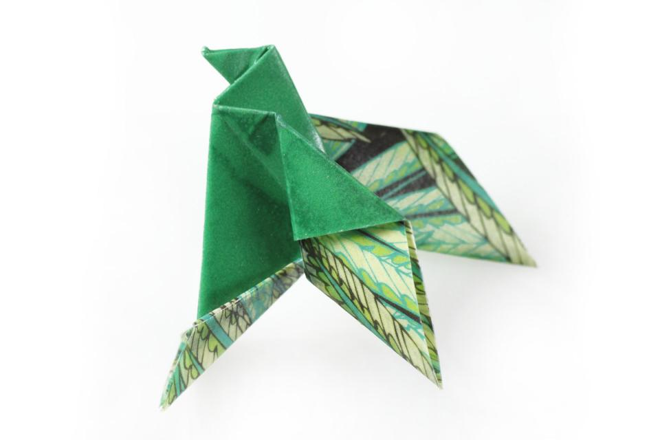 Origami bird brooch with safety pin, front view