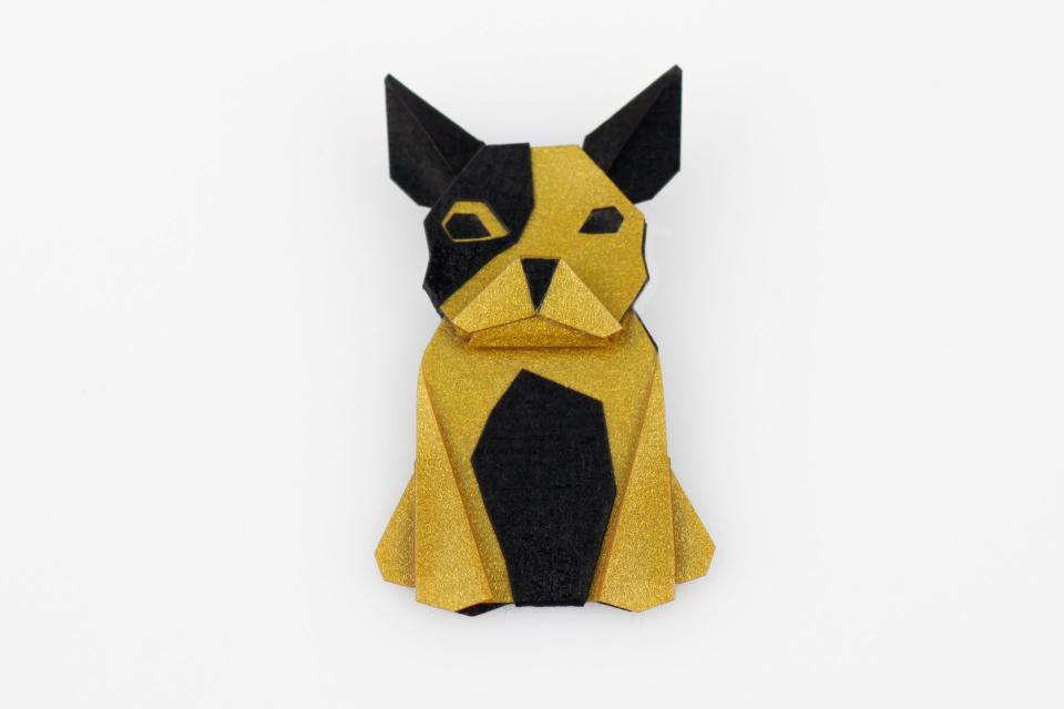 Dog shaped brooch in gold color