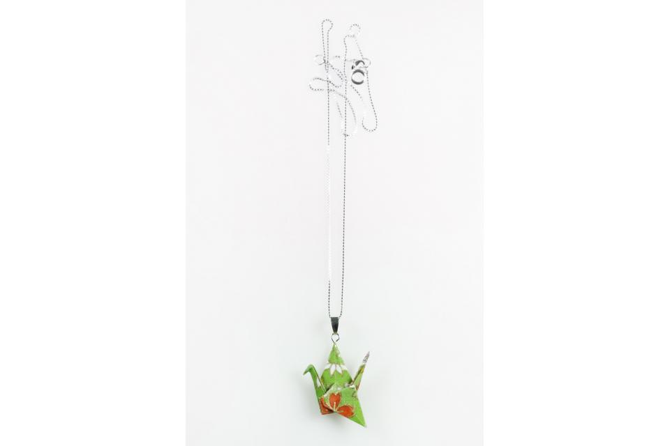 Women's origami crane and silver necklace accessory, front view
