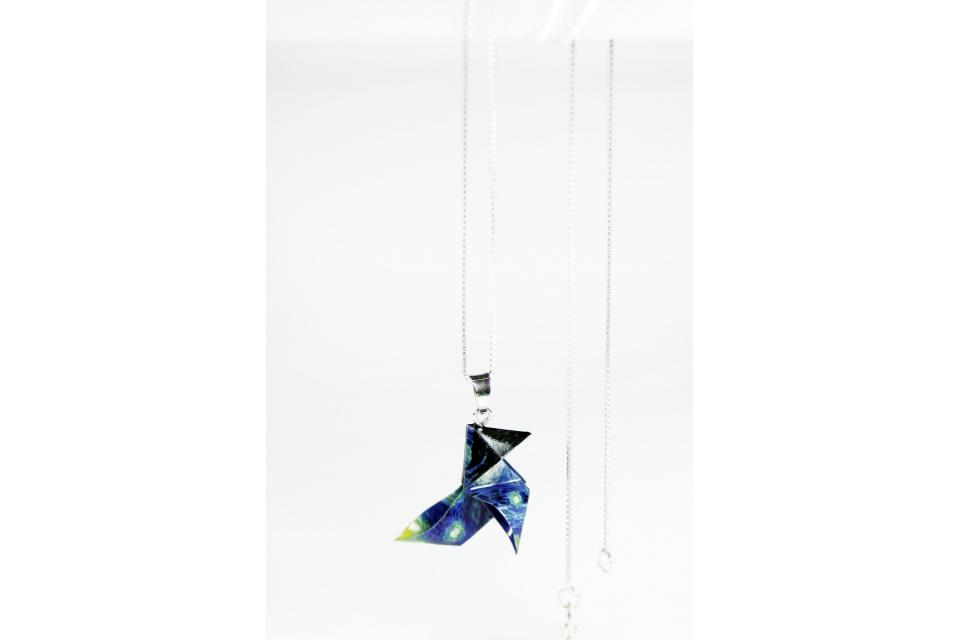 Pendant in the shape of a paper origami bird with a sterling silver chain