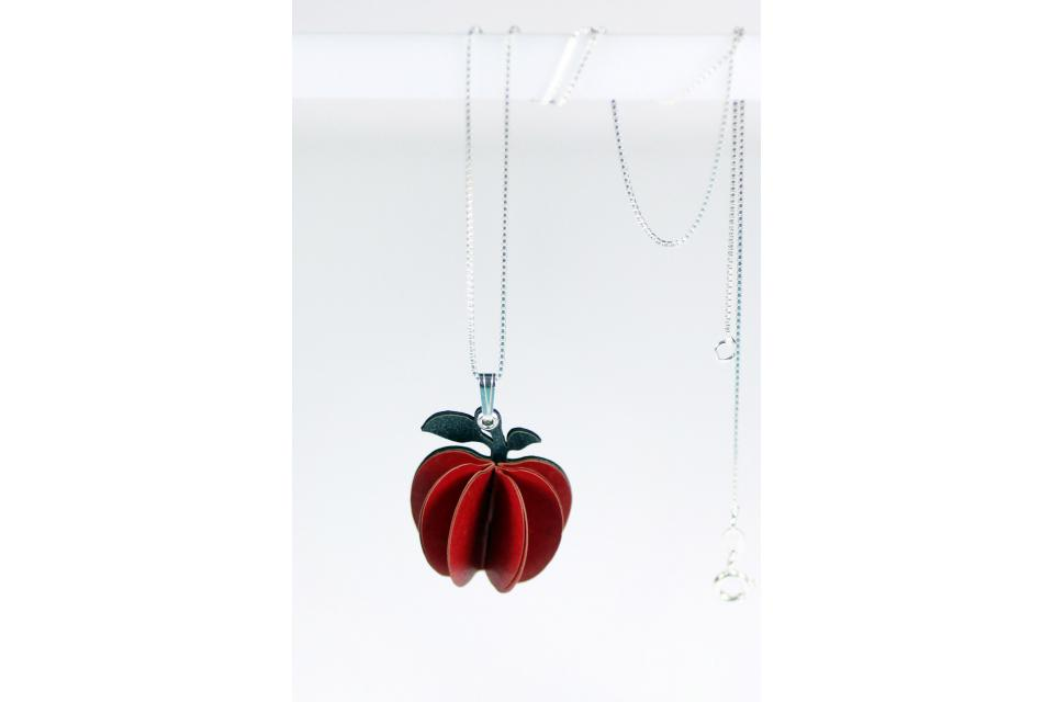 Handmade jewellery accessory in the shape of an apple to hang from the neck