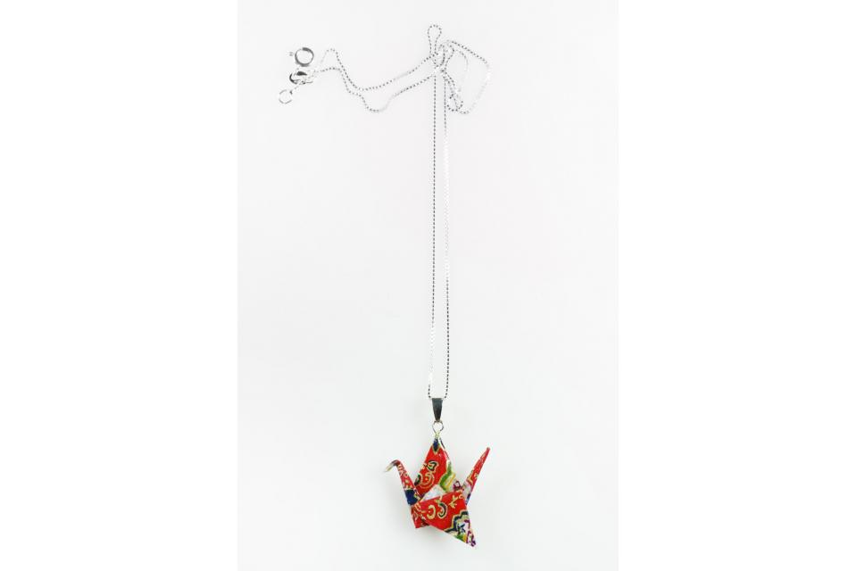 Women's origami crane and silver pendant accessory, front view
