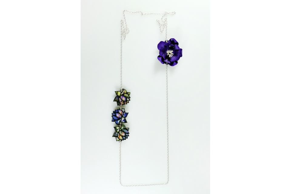 If you like purple color this necklace is for you. Made with 925 silver and flowers created through a manual process of modeling and folding the paper
