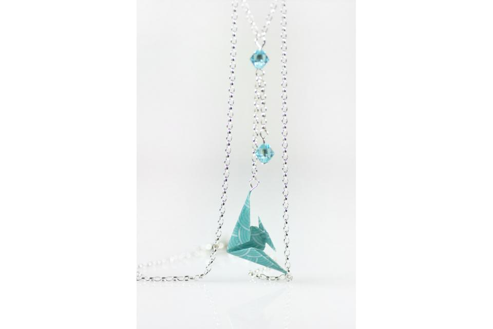 Origami fish necklace with sterling silver chain, front view