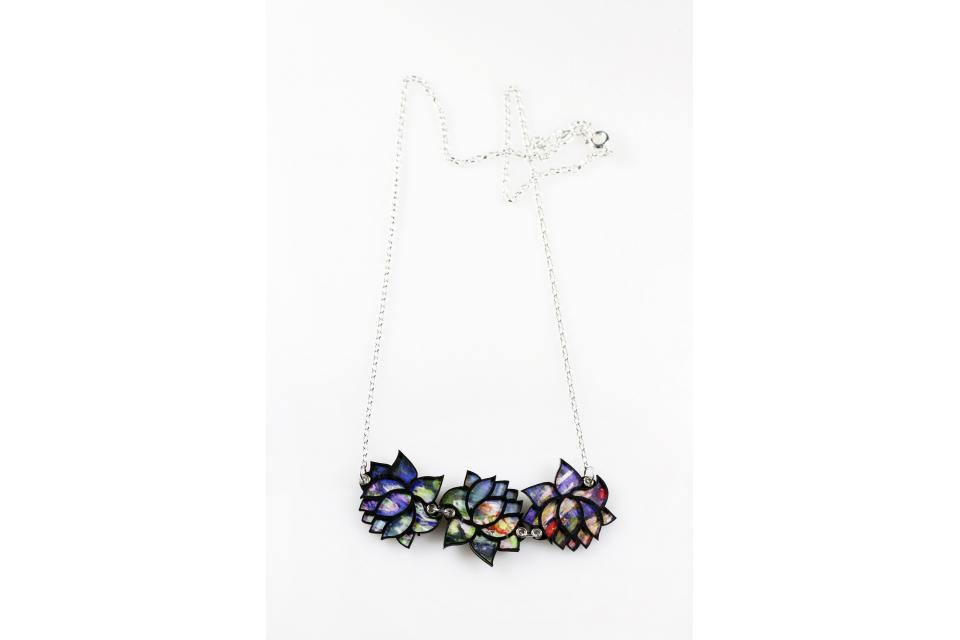 Short necklace mounted on sterling silver with three silhouettes of die-cut paper water lilies, which outline the image of the work Water Lilies