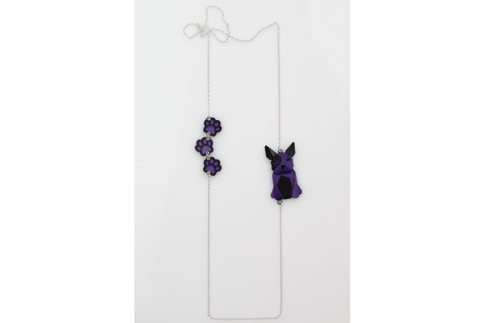 Silver necklace with a purple origami dog and footprints