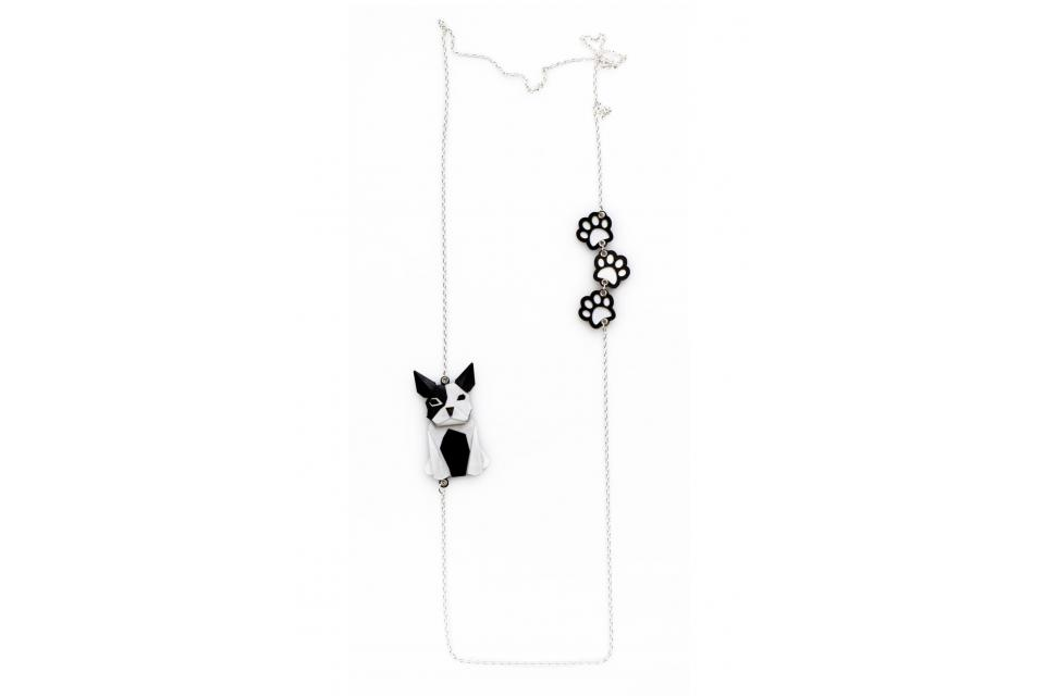 Silver necklace with a black and white origami dog and footprints