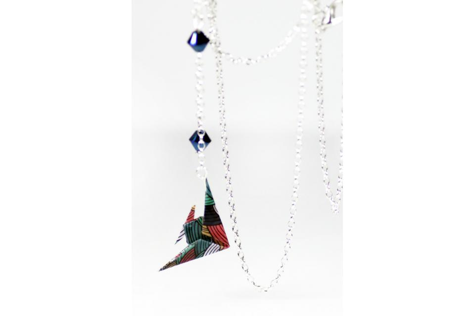 Handmade fish necklace made of paper and sterling silver, front view